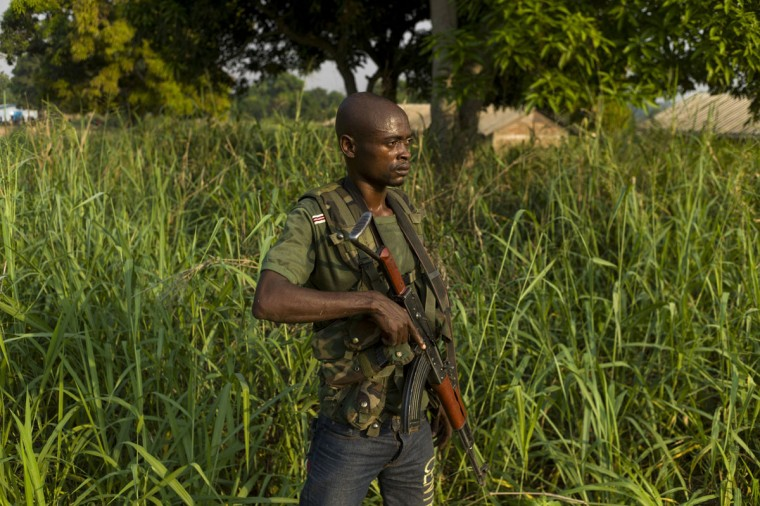 A member of the former Central African Armed Forces (FACA) and anti-balaka militian takes part in a drill in the suburbs of Bangui, on December 17, 2013. Anti-balaka is the term used to refer to the Christian militias formed in the Central African Republic after the rise to power of Michel Djotodia, leader of the mostly Muslim rebel coalition known as Seleka. (Fred Dufour/AFP/Getty Images)
