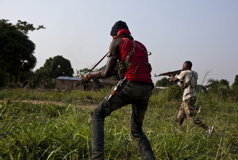 Anti-balaka militiamen, who were former members of the Central African Armed Forces (FACA), take part in a training session on the outskirts of Bangui on December 17, 2013. France today said other European nations would send troops to the Central African Republic to prop up a military force on the ground attempting to disarm militias dispensing deadly violence. The United Nations says some 210,000 people have been displaced in the capital Bangui alone in two weeks of unrest largely pitting Christians against Muslims, and France at the weekend called for more help from its European partners to assist its 1,600 troops on the ground. (Ivan Lieman/AFP/Getty Images)