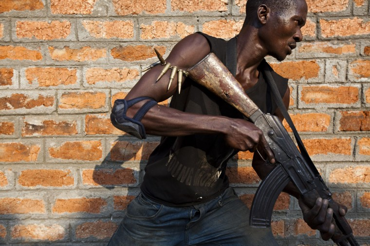 An anti-balaka militiamen, who was a former member of the Central African Armed Forces (FACA), takes part in a training session on the outskirts of Bangui on December 17, 2013. France today said other European nations would send troops to the Central African Republic to prop up a military force on the ground attempting to disarm militias dispensing deadly violence. The United Nations says some 210,000 people have been displaced in the capital Bangui alone in two weeks of unrest largely pitting Christians against Muslims, and France at the weekend called for more help from its European partners to assist its 1,600 troops on the ground. (Ivan Lieman/AFP/Getty Images)