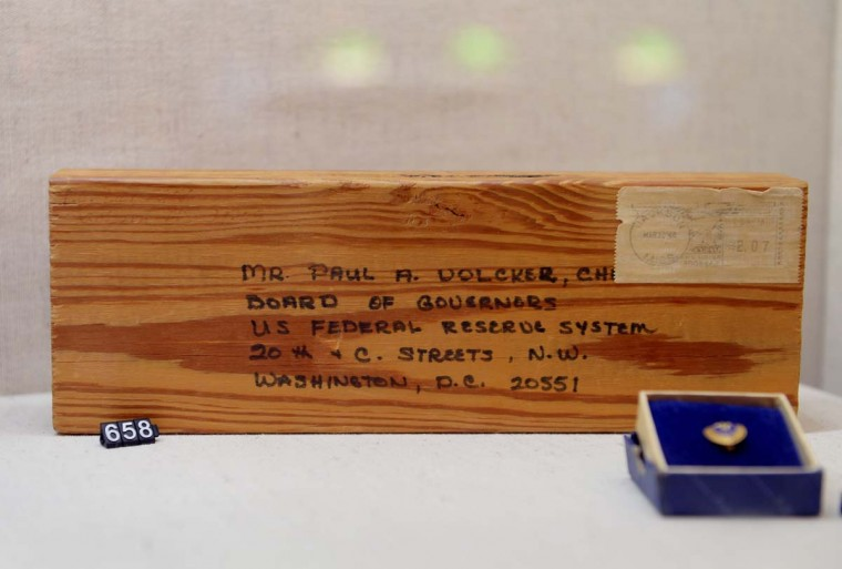 "A piece of wood mailed to Paul Volcker, Federal Reserve Chairman from 1979 to 1987, as part of a protest by building contractors and carpenters who claimed their lumber was unneded since no one was buying houses due to high interest rates at the time, sits on display in the exhibition ""The Fed at 100"" at the Museum of American Finance December 17, 2013 in New York. The exhibition marks the 100th anniversary of the Federal Reserve System on Monday. The Fed was created on December 23, 1913, with the enactment of the Federal Reserve Act, largely in response to a series of financial panics, particularly a severe panic in 1907. Over time, the roles and responsibilities of the Federal Reserve System have expanded and its structure has evolved. Events such as the Great Depression were major factors leading to changes in the system. The approval process for new leader Janet Yellen was pushed last week into January. (STAN HONDA/AFP/Getty Images)"