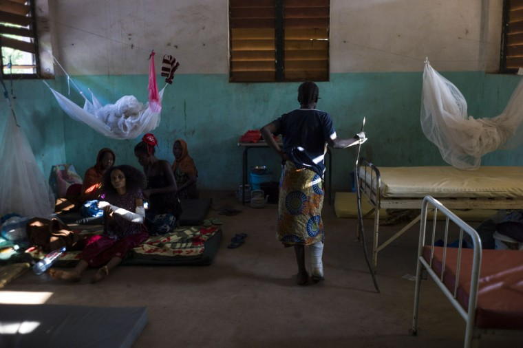 Patients wait in their room in the hospital in Bossangoa on December 18, 2013. Wrenched apart by sectarian violence, the Central African Republic town of Bossangoa has become little more than a ghost town. (Fred Dufour/AFP/Getty Images)