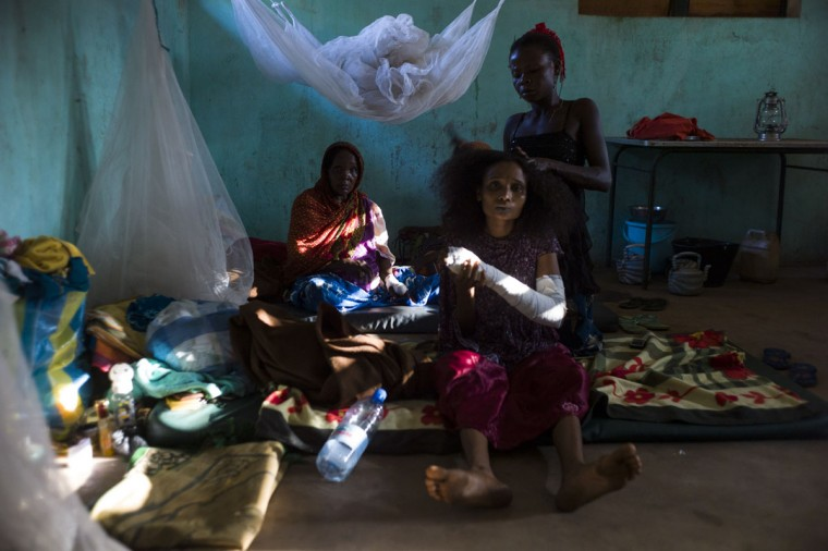 Patients wait in their room in the hospital in Bossangoa on December18, 2013. Wrenched apart by sectarian violence, the Central African Republic town of Bossangoa has become little more than a ghost town. (Fred Dufour/AFP/Getty Images)