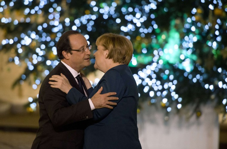 French President Francois Hollande welcomes German chancellor Angela Merkel as she arrives at the Elysee presidential palace on December 18, 2013 in Paris. Fresh from her expected re-election as chancellor, Merkel headed to Paris for talks ahead of an EU leaders summit that will focus on joint defense policy. (Alain Jocard/AFP/Getty Images )