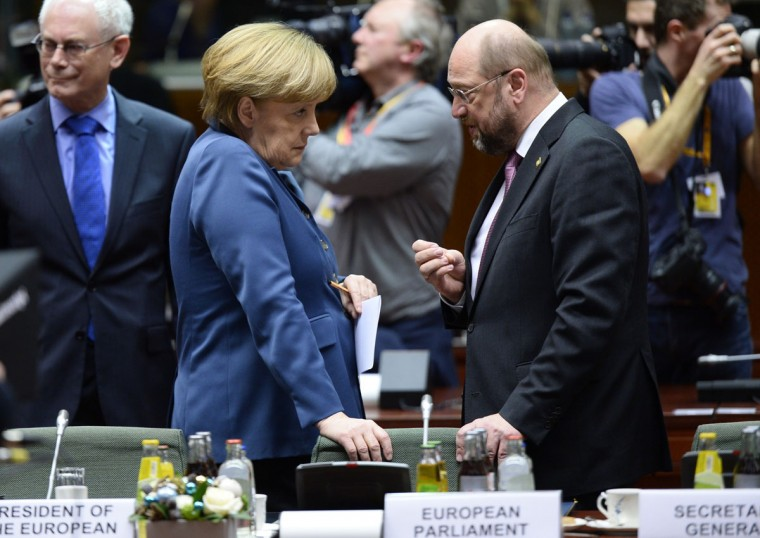 German Chancellor Angela Merkel (L) talks to European Parliament President Martin Schulz during an EU summit focused on the common security, Defence policy and Economic and Monetary union, in Brussels on December 19, 2013. The European Union took a historic leap towards greater integration just hours ahead of a summit today, with a deal on a banking union to prevent a re-run of the eurozone's recent crisis. (Lionel Bonaventure/AFP/Getty Images)