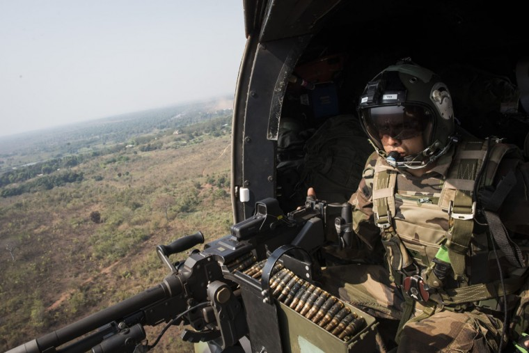 A French army soldier taking part in the Sangaris military operation in Central Africa checks his machine gun as he flies with a helicopter above Bossangoa on December 19, 2013. The Central African Republic's mostly Muslim ex-rebels killed nearly 1,000 people in the capital Bangui two weeks ago in a rampage avenging deadly Christian militia attacks, Amnesty International said in a report today. The death toll was significantly higher than earlier estimates by the United Nations, which spoke of 450 killed in Bangui and another 150 elsewhere in the country. (Fred Dufour/AFP/Getty Images)