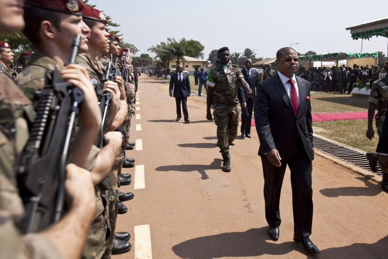 Central African Prime Minister Nicholas Tiangaye walks past French soldiers during a ceremony in Bangui on December 19, 2013 marking the transfer of authority of the Multinational Force of Central Africa (FOMAC) to the African-led International Support Mission to the Central African Republic (MISCA), mandated by the United Nations. (Ivan Lieman/AFP/Getty Images)
