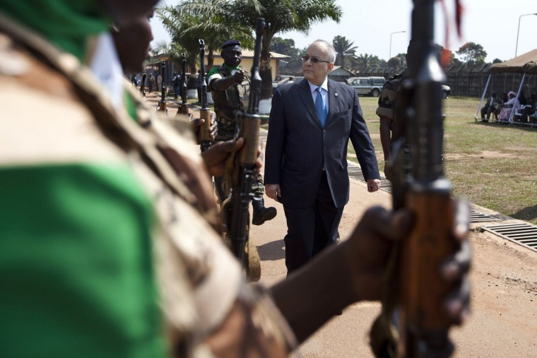 The General Secretary of the CEEAC (The Economic Community of Central African States) Ahmad Allam-Mi walks past former Multinational Force of Central Africa (FOMAC) troops during a ceremony in Bangui on December 19, 2013 marking the transfer of authority of the FOMAC to the African-led International Support Mission to the Central African Republic (MISCA), mandated by the United Nations. (Ivan Lieman/AFP/Getty Images)