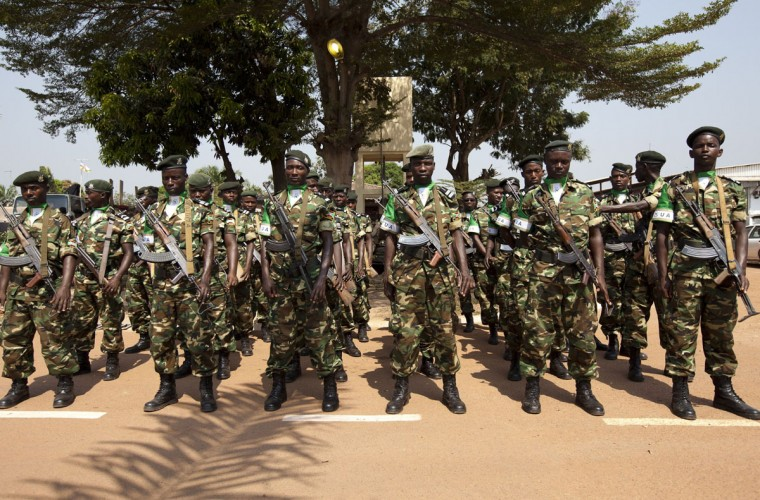 Burundian soldiers stand at attention during a ceremony in Bangui on December 19, 2013 marking the transfer of authority of the FOMAC to the African-led International Support Mission to the Central African Republic (MISCA), mandated by the United Nations. (Ivan Leiman/AFP/Getty Images)