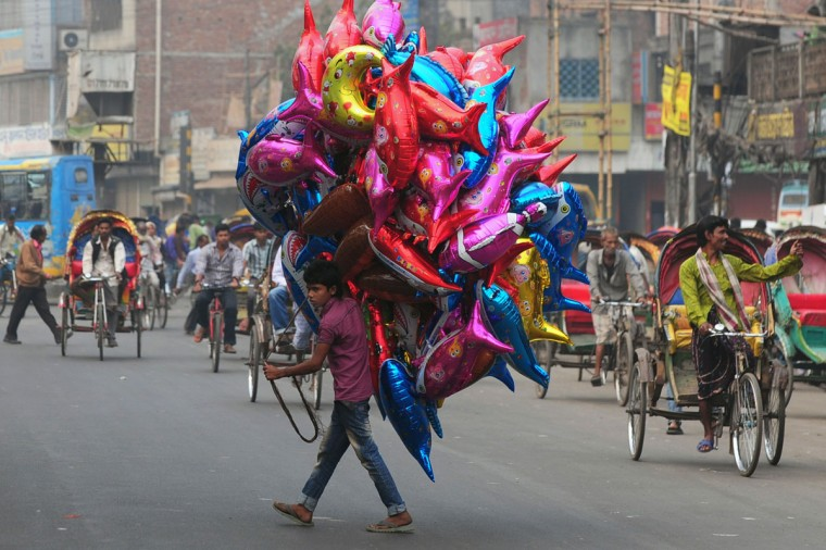 A Bangladeshi vendor sells balloons during an ongoing blockade organised by Bangladesh Nationalist Party (BNP) activists and its Islamist allies in Dhaka on December 21, 2013. Bangladesh's main opposition party called for a 83-hour blockade, rejecting plans for a January 5 election and plunging the nation into fresh political turmoil. (Munir uz Zaman/AFP/Getty Images)