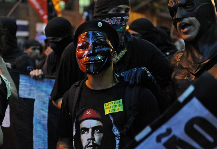 A demonstrator takes part in a protest against a public transport fare hike announced for January 2014 by Rio de Janeiro's Mayor Eduardo Paes, in the streets of the Brazilian city, on December 20, 2013. (Tasso Carcelo/AFP/Getty Images )