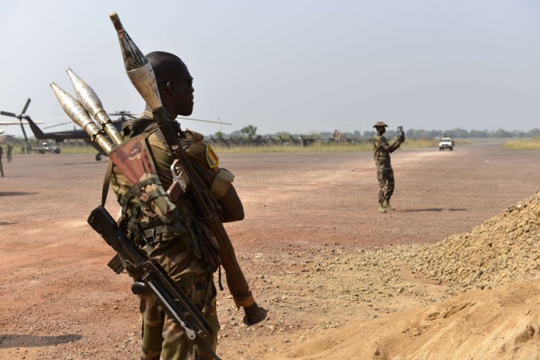 A Chadian soldier with rocket-propelled grenade launcher stands guard at their base near the International Airport in Bangui on December 21, 2013. More than 30 people including a Chadian peacekeeper have been killed in a fresh outbreak of brutal sectarian violence in the Central African Republic capital, sources said yesterday. (Miguel Medina/AFP/Getty Images)