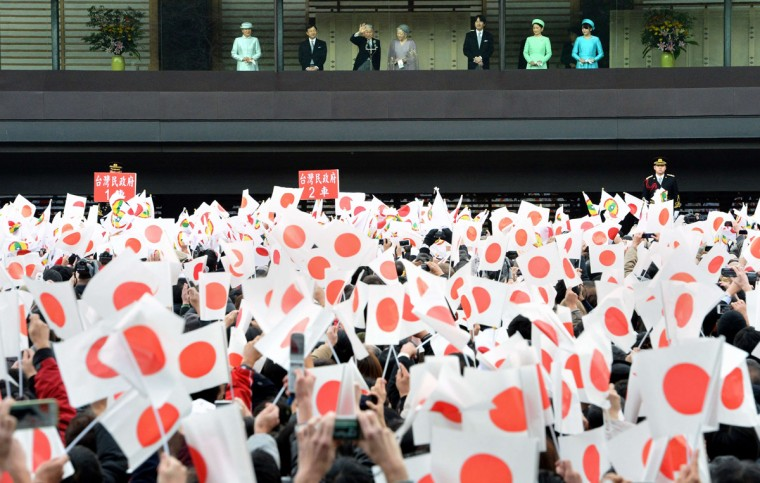 Accompanied by royal family members, Japanese Emperor Akihito (3rd L) waves from the balcony to well-wishers celebrating his birthday at the Imperial Palace in Tokyo on December 23, 2013. The emperor turned 80 years old on December 23. L-R: Crown Princess Masako, Crown Prince Naruhito, emperor, Empress Michiko, Prince Akishino, Princess Kiko and Princess Mako. (Toru Yamanaka/AFP/Getty Images)