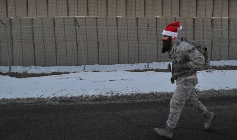 A U.S. soldier takes part in the Christmas 5-kilometer race at the U.S. Transit Center of Manas, Kyrgyzstan on December 25, 2013. (Vyacheslav Oseled/AFP/Getty Images)