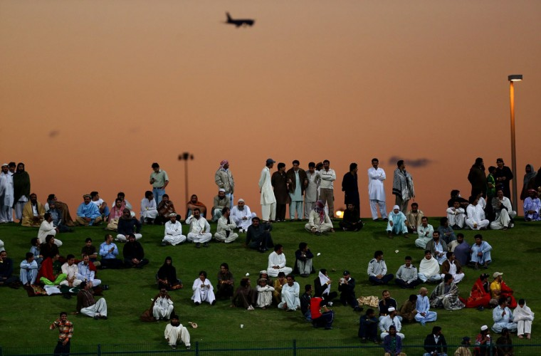 Spectators watch the fourth One Day International cricket match between Sri Lanka and Pakistan in Abu Dhabi on December 25, 2013. (Marwan Naamani/AFP/Getty Images)