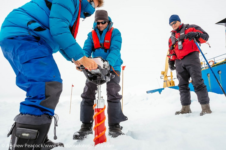 This handout image released by the Centre of Excellence for Climate System Science at the University of New South Wales and taken by Andrew Peacock of www.footloosefotography.com on December 27, 2013 shows people drilling in the ice next to the ship MV Akademik Shokalskiy (R), which is trapped in the ice at sea off Antarctica. A Chinese icebreaker was on December 27 closing in on the frozen seas where the scientific mission ship was trapped off Antarctica, as those onboard welcomed the easing of blizzard conditions. The ship, with 74 people on board, has been trapped in ice about 100 nautical miles east of the French base Dumont D'Urville since December 24. (Andrew Peacock/footloosefotography.com/AFP/Getty Images)