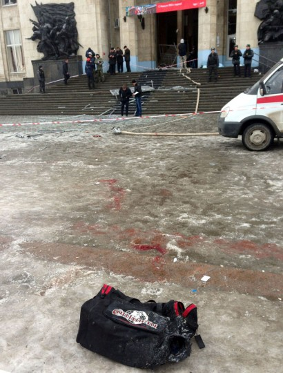 A bag lies on the ground as Russian security personnel inspect the damage at a train station following a suicide attack in the city of Volgograd, about 560 miles southeast of Moscow. (AFP/Getty Images)