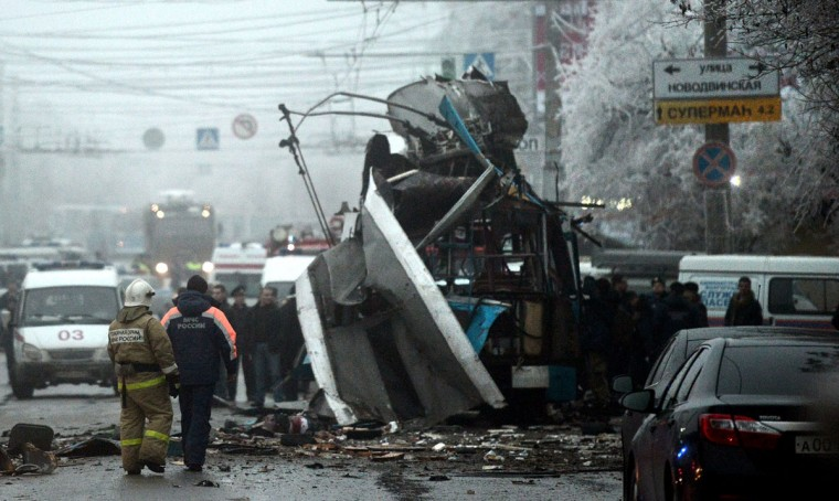 Russian firefighters and security personnel inspect the destroyed trolley bus in Volgograd on December 30, 2013. (AFP/Getty Images)