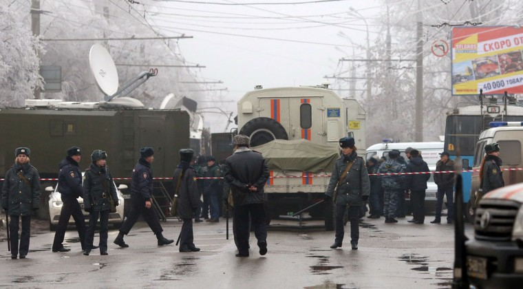 Russian policemen guard the site of a deadly bombing on a packed trolley bus in Volgograd on December 30, 2013. The bombing was caused by a male suicide bomber, investigators said today, as the official death toll rose to 14 people. (AFP/Getty Images)