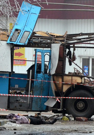 A body lies in front of the wreckage of a bus following an suicide attack that destroyed a packed trolley bus killing 14 people in the southern Russian city of Volgograd on December 30, 2013. (AFP/Getty Images)