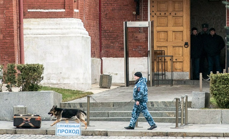 Russian police dog sniffes around a box near Spasskaya tower at the Red square in central Moscow on December 30, 2013 as security measures were increased following twin blasts Volgograd. (DMITRY SEREBRYAKOV / AFP/Getty Images)