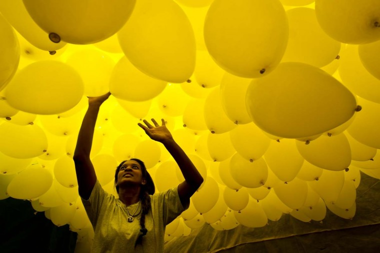 Thousands of biodegradable balloons are released by members of the city's commercial association at Patio do Colegio, the site of the city's foundation in 1554, on December 30, 2013 in Sao Paulo, Brazil. The workers of the association began releasing balloons in 1992 in which has now turned into a tradition to celebrate the New Year. (Nelson Almeida/AFP/Getty Images)