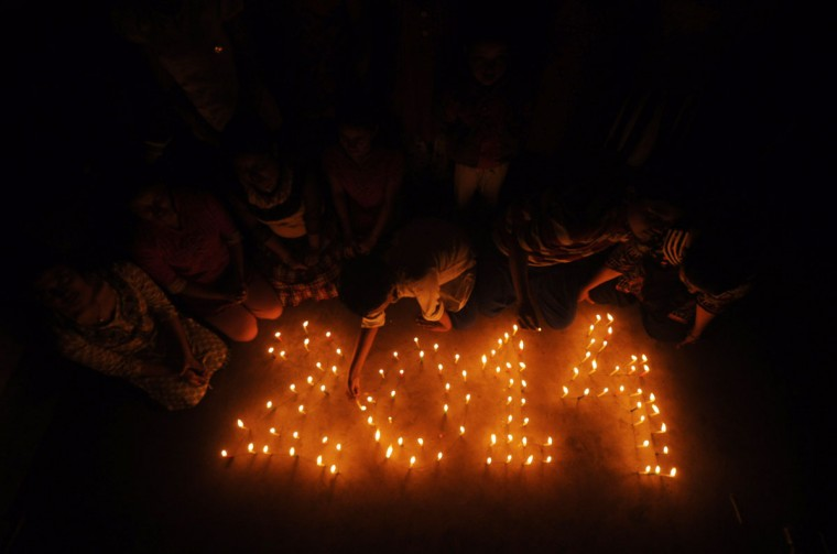 Indian school children light candles forming the date '2014' at a school in Agartala on December 30, 2013, one day ahead of New Year's celebrations. People across the world are preparing to welcome 2014. (Arindam Dey/AFP/Getty Images)