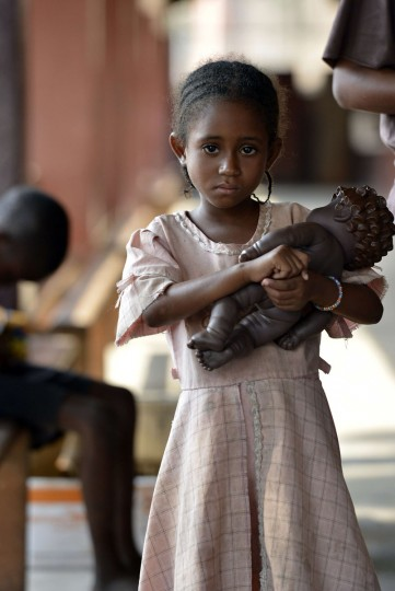 A child who suffers from nutritional problems, holds a doll, at the therapeutical nutritional unit of the Pedriatic hospital in Bangui on December 30, 2013. More than 1,000 people are believed to have been killed in three weeks of sectarian violence in Bangui alone. (MIGUEL MEDINA / AFP/Getty Images)