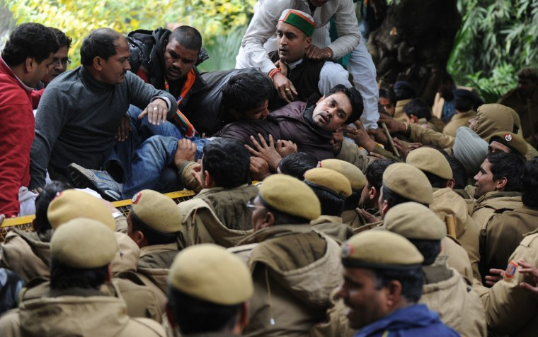Indian Bharatiya Janata Party leader Anurag Thakur (center) tries to cross a police barricade during a protest outside Congress Vice President Rahul Gandhi's residence in New Delhi on December 31, 2013. BJP activists and supporters held protests outside Rahul Gandhi's house to demand action against Congress leader and Himachal Pradesh Chief Minister Virbhadra Singh, over corruption allegations against him. (SAJJAD HUSSAIN / AFP/Getty Images)