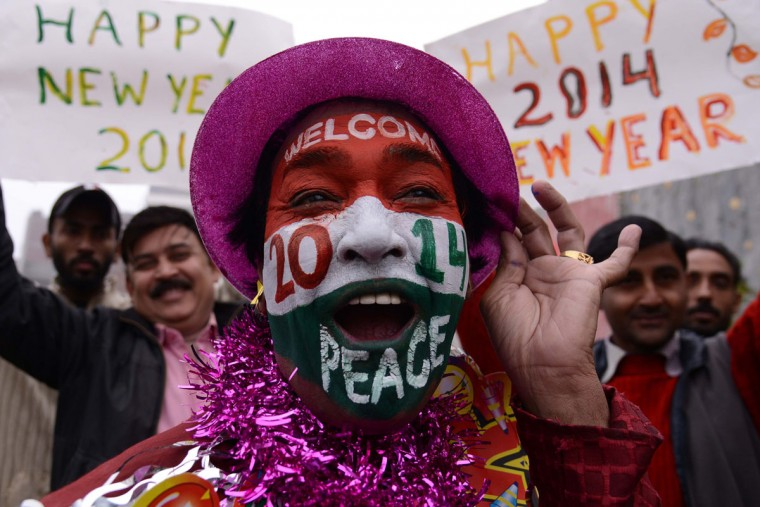 An Indian reveller poses on New Year's Eve in Amritsar on December 31, 2013. Indians are preparing to welcome 2014, in contrast to last year which saw the country cancel most of its official New Year's celebrations after the fatal gangrape of a student on a New Delhi bus on December 16, which sparked protests and a year of introspection about women's rights. (Narinder Nanu/AFP/Getty Images)