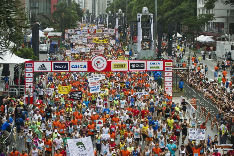 Runners take part in the 89th Sao Silvestre New Year's eve road race at the start, in Sao Paulo, Brazil, on December 31, 2013. Twenty-seven thousand runners participated in the 15 km traditional New Year's Eve event. (Nelson Almeida/AFP/Getty Images)