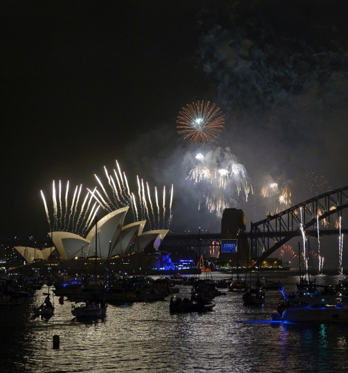 New Year's Eve fireworks erupt over Sydney's iconic Harbour Bridge (R) and the Opera House on January 1, 2014. Tonnes of explosives lit up Australia's biggest city, with fireworks shooting off the Opera House for the first time in more than 10 years as part of the extravaganza, focused on the Harbour Bridge. (Greg Wood/AFP/Getty Images)