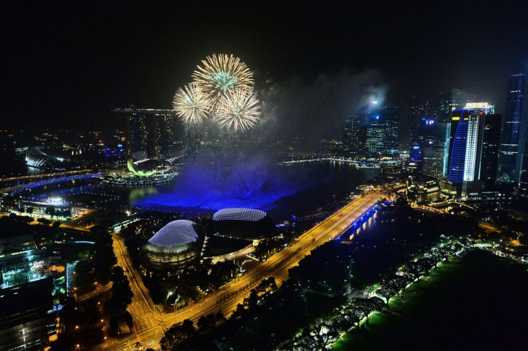 Fireworks burst over the Singapore skyline during New Year celebrations on January 1, 2014. An eight-minute firework display was launched in a five-pronged formation that illuminate the skyline to welcome 2014. (Roslan Rahman/AFP/Getty Images)