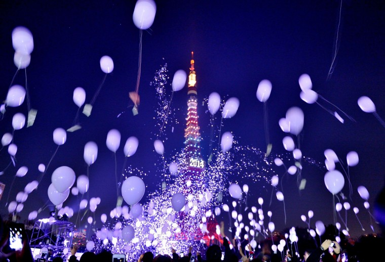 People release balloons to celebrate the New Year during an annual countdown ceremony in Tokyo on January 1, 2014. Some 2,000 balloons were released in the air, carrying with the visitors' wishes. (Kazuhiro Nogi/AFP/Getty Images)
