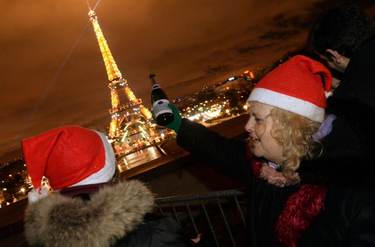 People celebrate with champagne on the Trocadero square, in front the Eiffel Tower in Paris, on December 31, 2013, during the New Year celebrations. (Pierre Andrieu/AFP/Getty Images)