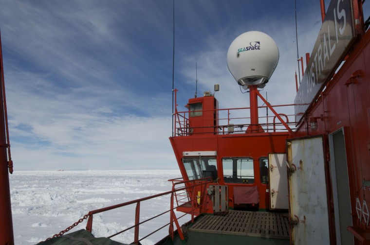 This photo provided by Fairfax Media Pool and released by the Australian Antarctic Division on January 2, 2014 shows the Chinese Antarctic vessel Xue Long (back L-in far distance) from the bridge of the Aurora Australis ship off Antarctica, both in the frozen waters to help rescue a nearby Russian research ship (not pictured). A helicopter mission to rescue 52 passengers trapped on the icebound Russian research ship MV Akademik Shokalskiy finally got underway in Antarctica on January 2, 2014 after a number of false starts and failed icebreaking attempts. It was expected to take at least five hours to ferry all passengers from the icebound vessel to the Xue Long -- 10 nautical miles distant -- by helicopter, with five flights of up to 12 passengers and a return journey taking 45 minutes. Under the aerial rescue plan outlined by the Australian Maritime Safety Authority (AMSA) earlier on January 2, the passengers will be moved from the Xue Long to Australia's Antarctic supply ship the Aurora Australis via a barge. (Jessica Fitzpatrick/Australian Antarctic Division/AFP/Getty Images)