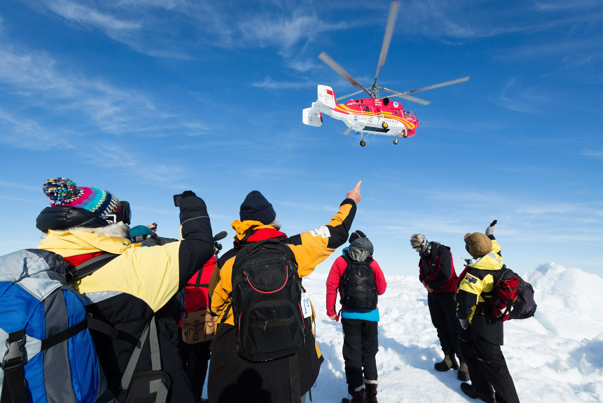 Helicopter rescue begins for passengers stuck in Antarctic ice