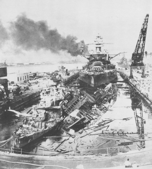 American detroyers Downes, left, and Cassin, right, lie ruined at a Pearl Harbor dry dock while the USS Pennsylvania, flagship of the Pacific fleet, is relatively undamaged behind them during the Dec. 7, 1941 Japanese attack on Pearl Harbor, Hawaii. (File photo)