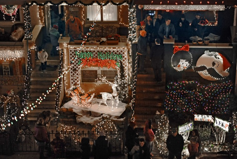 "After the grand lighting, visitors take in the ""Miracle on 34th Street"" displays, which include decorations featuring Natty Boh, Sally Utz and movies made in Maryland. (Kenneth K. Lam/Baltimore Sun)"