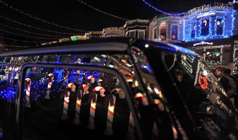"Holiday light displays reflect in a car window after the ""Miracle on 34th Street"" grand lighting on Nov. 30. (Kenneth K. Lam/Baltimore Sun)"