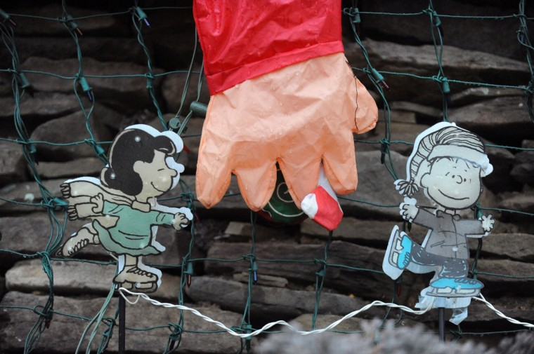 "A close-up view of Snoopy decorations that are part of this year's ""Miracle on 34th Street"" holiday display in Hampden. (Kenneth K. Lam/Baltimore Sun)"
