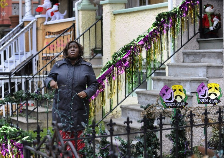 "Hacari Waithe, a new to W. 34th Street, makes final changes to her decorations an hour before the grand lighting of the ""Miracle on 34th Street"" display in Hampden. (Kenneth K. Lam/Baltimore Sun)"
