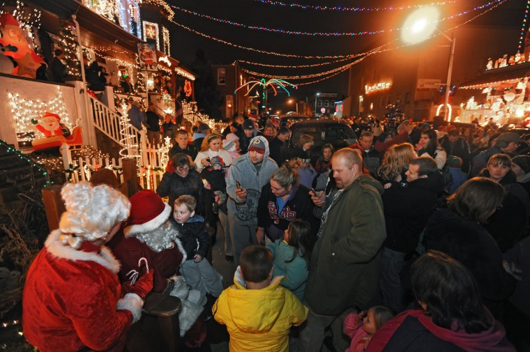 "Santa Claus sits with children after counting down to the annual lighting of the ""Miracle on 34th Street"" in Hampden. (Kenneth K. Lam/Baltimore Sun)"