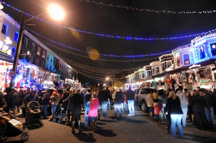 "Visitors walk through the 700 block of 34th Street enjoying the festive atmosphere after the ""Miracle on 34th Streeet"" grand lighting on Nov. 30. (Kenneth K. Lam/Baltimore Sun)"