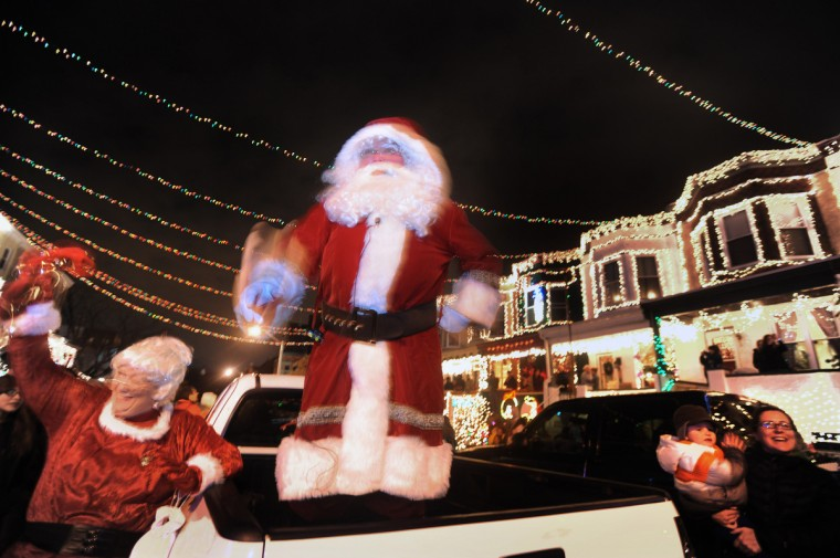 "The street illuminates as Santa and Mrs. Claus finish the countdown to the the grand lighting, kicking off the ""Miracle on 34th Street"" holiday celebration in Hampden. (Kenneth K. Lam/Baltimore Sun)"
