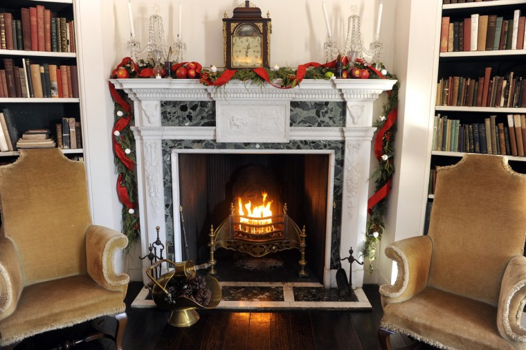 The fireplace in the Oval Library was decorated by The Manor Conservancy. (Barbara Haddock Taylor/Baltimore Sun)