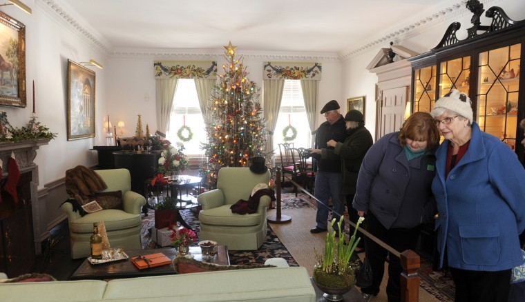 "Visitors walk through the Drawing Room, decorated by Mason's Crew in the style of the 1940s, for the ""Christmas Through the Ages"" tour at the Manor House at Ladew Gardens. (Barbara Haddock Taylor/Baltimore Sun)"