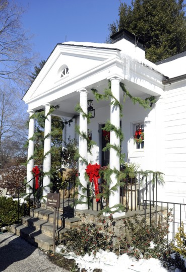 "The kitchen porch and entrance to the Manor House at Ladew Gardens, which is decorated in a ""Christmas Through the Ages"" theme. (Barbara Haddock Taylor/Baltimore Sun)"