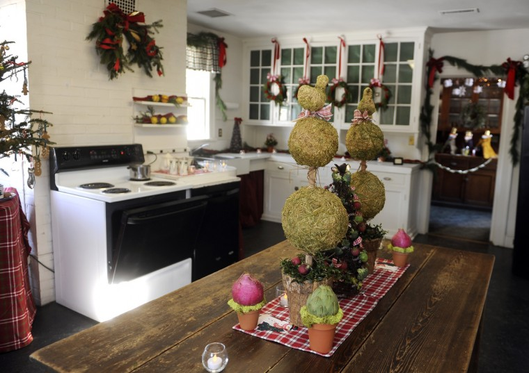 This is a view of the kitchen, which was decorated by the St. Georges Garden Club, at the Manor House at Ladew Gardens. (Barbara Haddock Taylor/Baltimore Sun)
