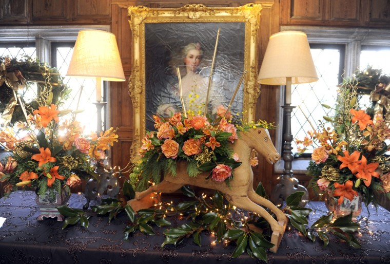 "Floral arrangements are displayed in the Elizabethan Room for the ""Christrmas Through the Ages"" tour by Jeanne Graham of Blue Sage Design at the Manor House at Ladew Gardens. (Barbara Haddock Taylor/Baltimore Sun)"