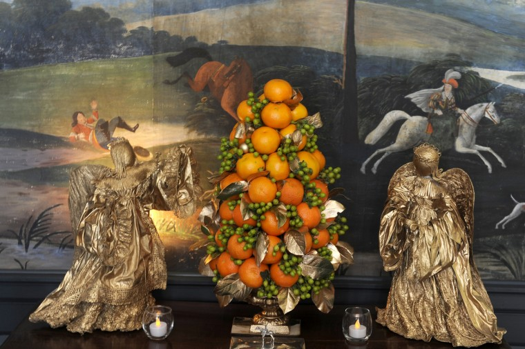 Angels and oranges are shown in the dining room, which was decorated by the Garden Club of Twenty for the holiday tour at the Manor House at Ladew Gardens. (Barbara Haddock Taylor/Baltimore Sun)